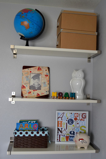 baby boy nursery shelves - vintage photo frame, modern globe