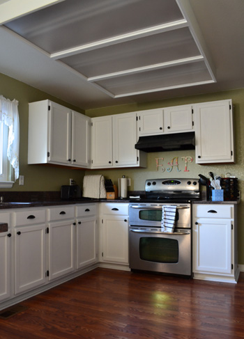 Painting our kitchen cabinets suddenly inspired for Spray paint kitchen cabinets white